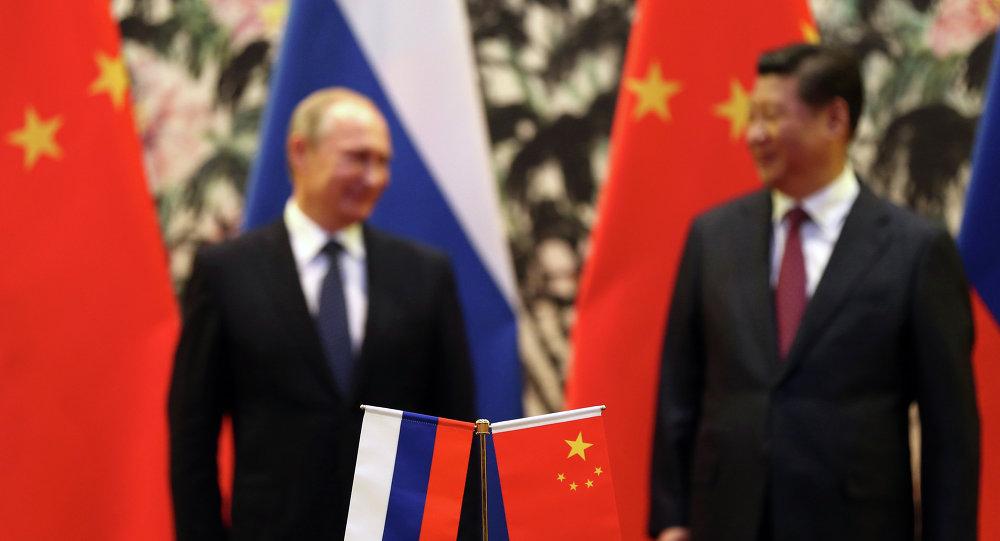 俄羅斯總統弗拉迪米爾•普京與中華人民共和國國家主席習近平 (資料圖片)