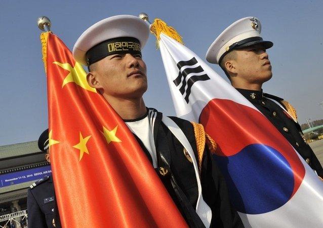 中韩外长就两国关系改善和发展进行充分讨论