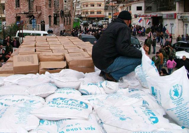 俄軍方已將噸余人道主義救援物資運往拉塔基亞難民中心