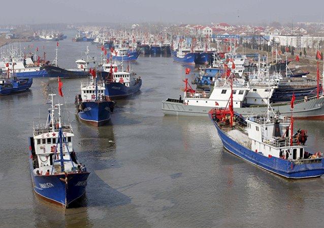 廷海警击沉的中国渔船上的四名船员回国
