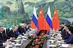 普京:俄中两国商定加大经济合作力度