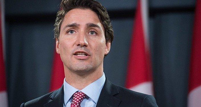 媒体:加拿大总理访华旨在加强中加经贸合作并重修两国关系