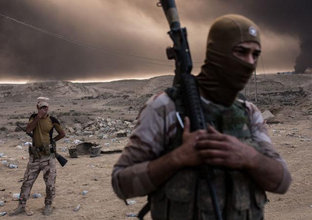伊拉克什叶派民兵在摩苏尔西部与伊斯兰国组织开战