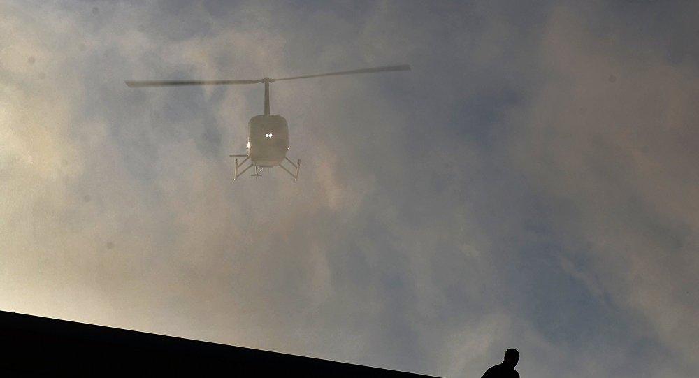 消息人士:俄阿爾泰共和國捷列茨科耶湖或發現失事直升機殘骸
