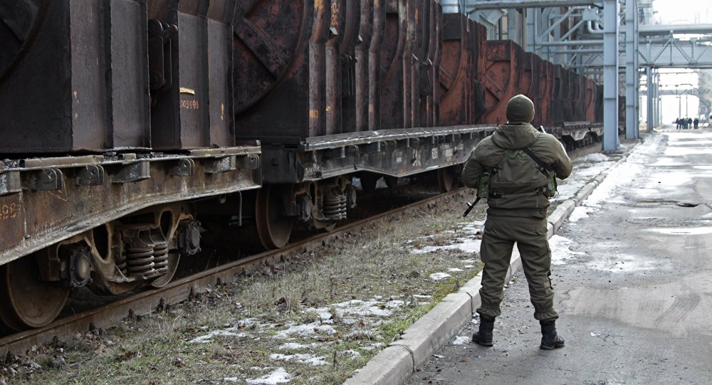 A serviceman on guard at Hughes Metallurgical Plant in Donetsk, the Donetsk People's Republic