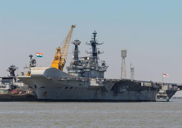Ship at Mumbai Harbour. Taken from Mumbai-Elephanta ferry. Maharashtra, India.