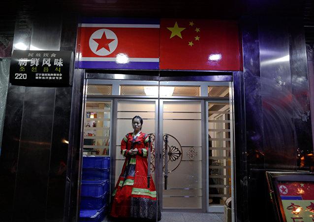 中国政府决定关闭年底前关闭所有涉朝企业