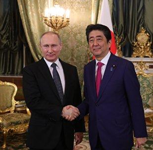 普京祝贺安倍晋三再度被选为日本自民党总裁
