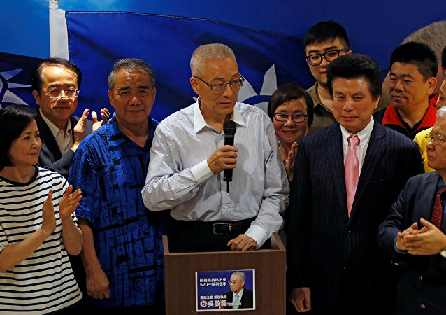 Wu Den-yih (C), newly elected chairman of Taiwan's opposition Nationalist Kuomintang Party
