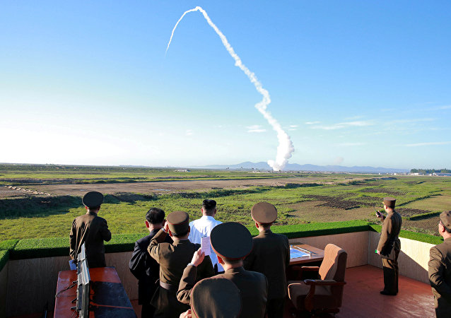 North Korean leader Kim Jong Un watches the test of a new-type anti-aircraft guided weapon system