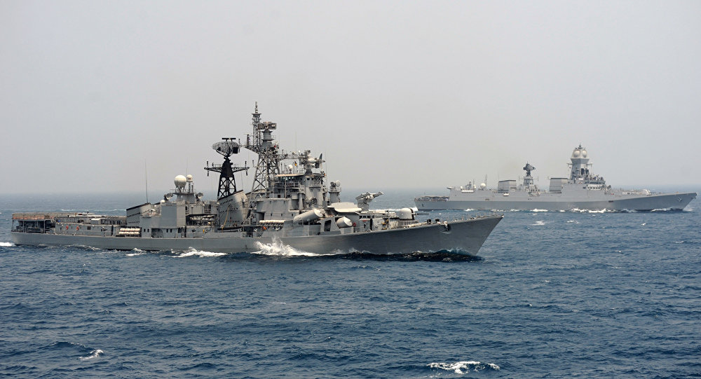 India's naval ship INS Ranvir (L) along with the INS Chennai take part in an exercise drill in the Bay Of Bengal