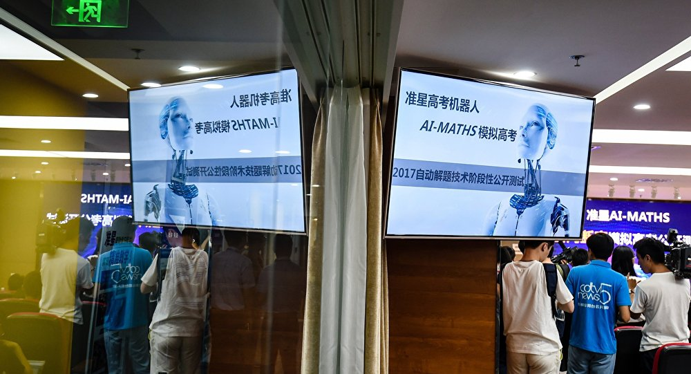The media watching as an artificial intelligence machine named AI-MATHS takes a maths exam in Chengdu