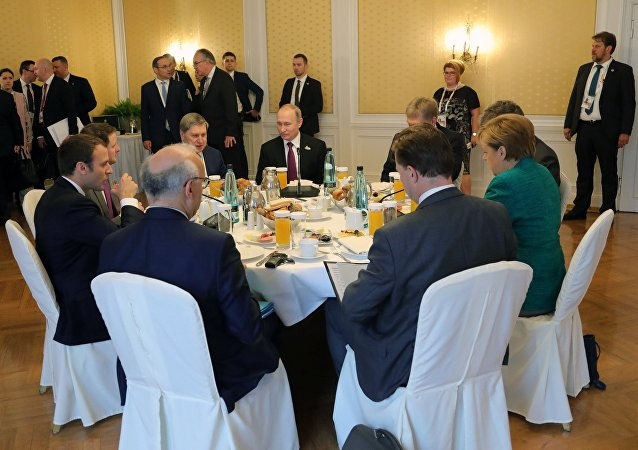 俄德法领导人重申遵守乌东部停火重要性