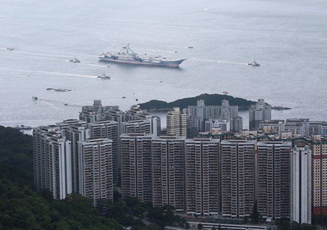 China's first aircraft carrier Liaoning sails into Hong Kong on its maiden visit to Hong Kong
