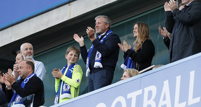 Chelsea FC owner Roman Abramovich, center, applauds at the end of the English Premier League last round soccer match between Chelsea and Sunderland
