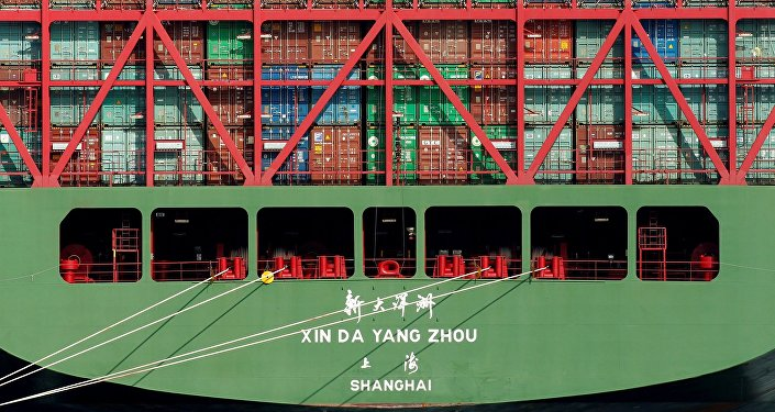China Shipping containers sit on a ship in the Port of Los Angeles after being imported to the U.S.