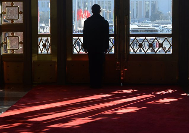 A security guard stands by a gate during the closing ceremony of the Chinese National People's Congress