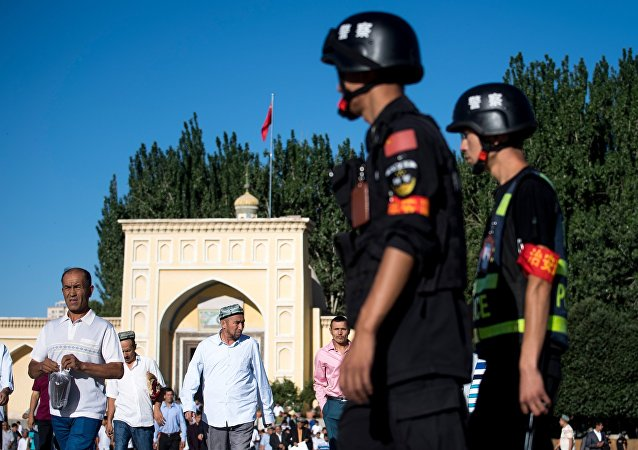 Police patrolling as Muslims leave the mosque after the morning prayer in the old town of Kashgar in China's Xinjiang Uighur Autonomous Region