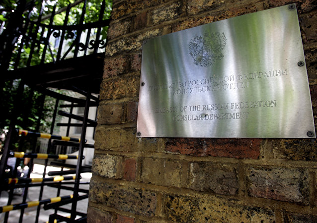 A sign on the wall at the entrance to the Russian Embassy in London