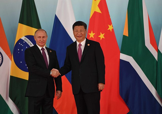 中国国家主席习近平迎接出席峰会的金砖国家领导人
