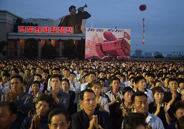 Participants of a mass celebration in Pyongyang for scientists involved in carrying out North Korea's largest nuclear blast to date