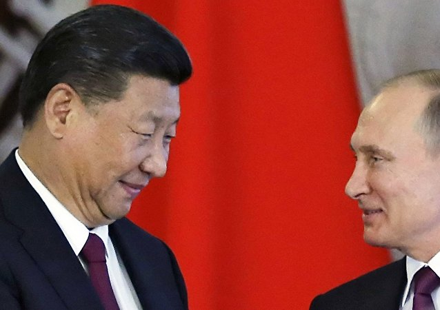 Russian President Vladimir Putin, right, and Chinese President Xi Jinping attend a signing ceremony following their talks in the Kremlin in Moscow