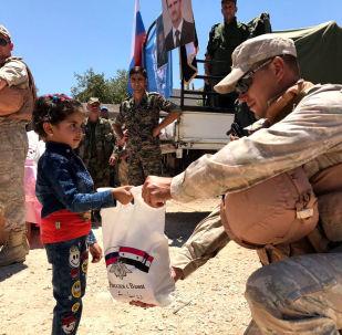 俄军9月向叙利亚难民分发约90吨人道主义援助物资