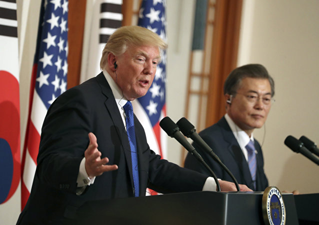 President Donald Trump, left, speaks as South Korean President Moon Jae-in looks on in a joint news conference at the Blue House in Seoul