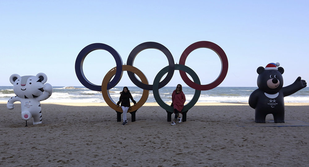 The Olympic Rings, Winter Olympic Games' official mascots, white tiger Soohorang, left, for the Olympics, and black bear Bandabi for Paralympics are placed at the Gyeongpodae beach