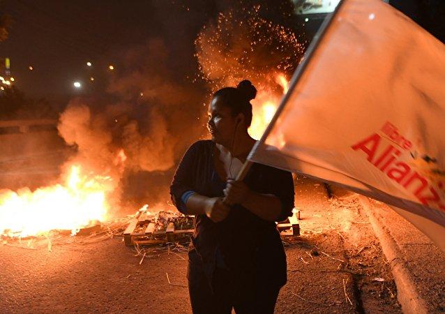 洪都拉斯总统大选失利候选人称该国反对派将继续斗争