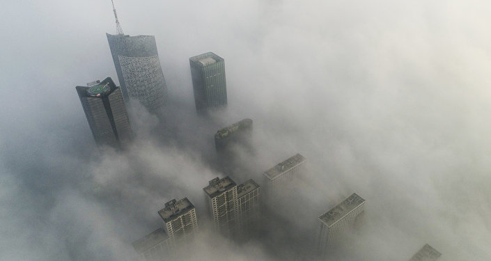 Skyscrapers are shrouded in fog in Hefei in eastern China's Anhui province