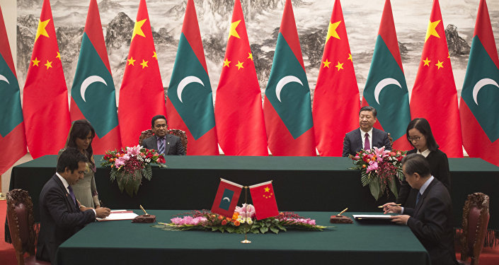 Maldives' President Abdulla Yameen, left back, and China's President Xi Jinping, right back, witness a signing ceremony at the Great Hall of the People in Beijing