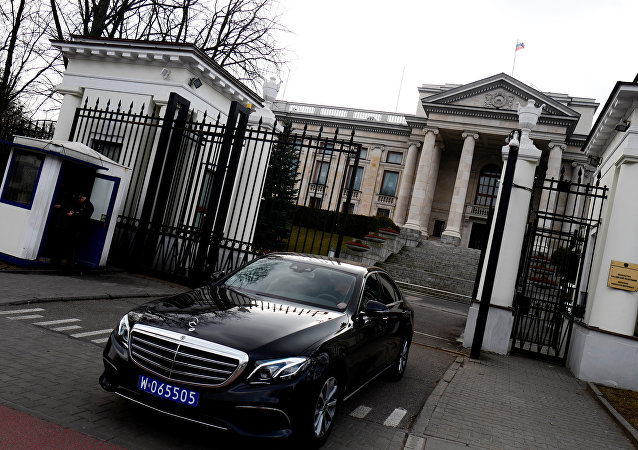 Car leaves through the gate of the Russian embassy building in Warsaw