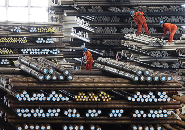 Workers transport steel bars at a plant of Dongbei Special Steel Group Co Ltd. in Dalian