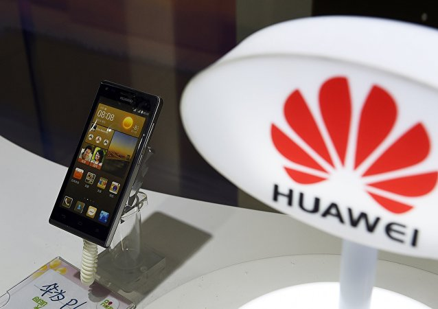 A mobile phone made by Chinese telecom equipment maker Huawei displayed in a store in Beijing