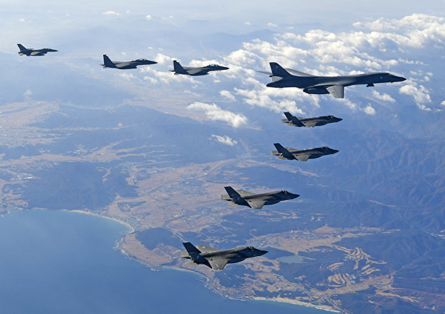 U.S. Air Force B-1B bomber, right top, flies over the Korean Peninsula with South Korean fighter jets and U.S. fighter jets during the combined aerial exercise
