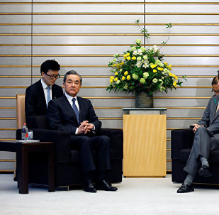 Chinese government's top diplomat, State Councillor Wang Yi meets with Japan's Prime Minister Shinzo Abe and Foreign Minister Taro Kono