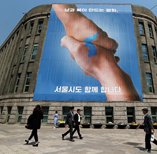 A large banner adorns the exterior of City Hall ahead of the upcoming summit between North and South Korea in Seoul