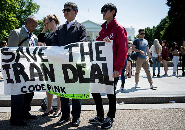 Protesters stand outside the White House as US President Donald Trump announces the United State's withdrawal from the Iran nuclear deal