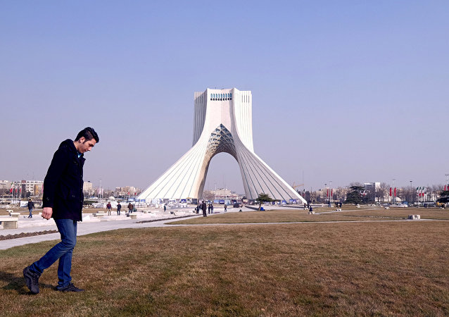A man walks past Azadi Tower (Liberty Tower) in Azadi Square in Tehran