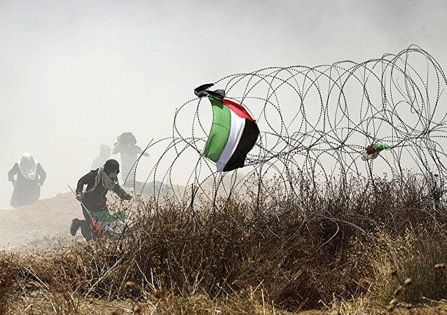 巴以冲突已致59巴勒斯坦人死亡
