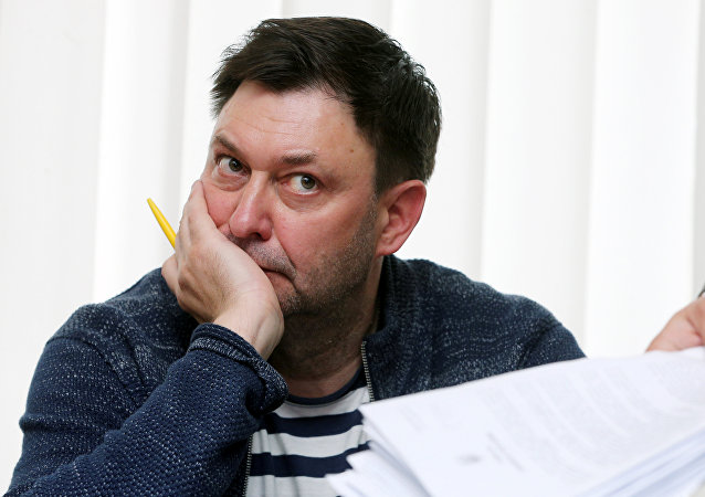 Journalist Vyshinsky, the director of Russian state news agency RIA Novosti Ukraine, attends a preliminary court hearing in Kherson