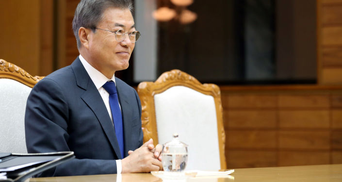 美韩元首指出全面落实美朝新加坡峰会协议的重要性