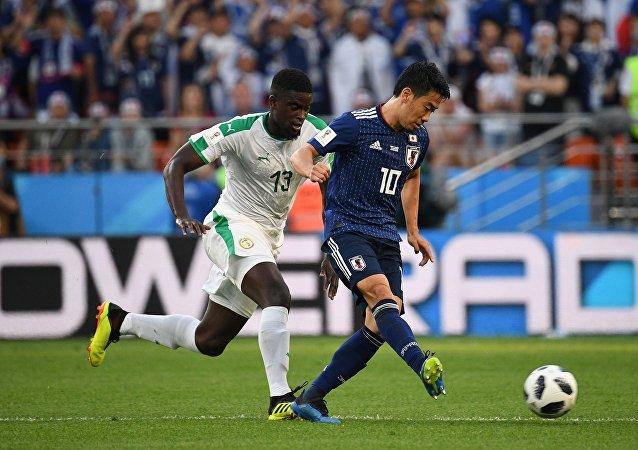 日本隊在世界杯比賽中與塞內加爾隊戰平