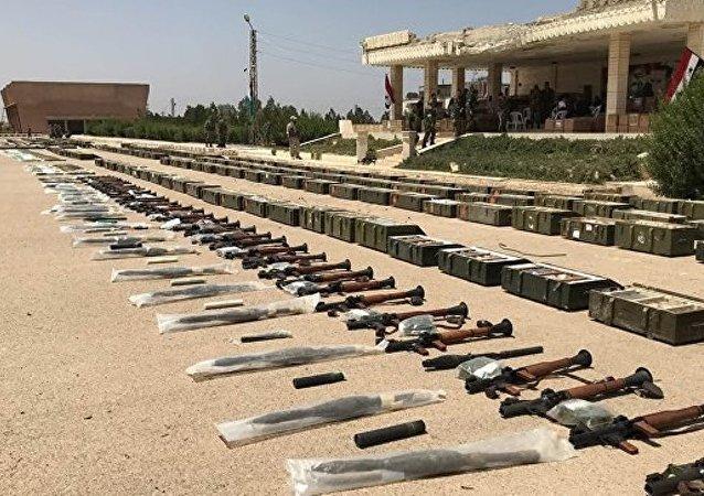 武裝分子在德拉省丟棄成噸彈藥和武器