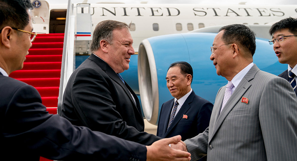 U.S. Secretary of State Mike Pompeo is greeted by North Korean Director of the United Front Department Kim Yong Chol, and North Korean Foreign Minister Ri Yong Ho, as he arrives at Sunan International Airport in Pyongyang