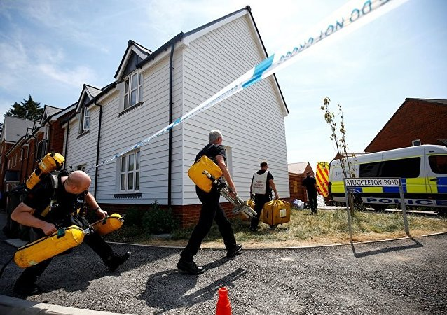 Fire and Rescue Service personel arrive with safety equipment at the site of a housing estate on Muggleton Road, after it was confirmed that two people had been poisoned with the nerve-agent Novichok, in Amesbury
