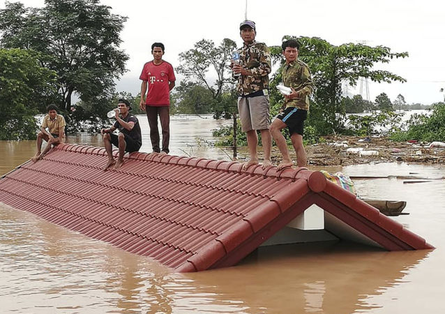 老挝国家媒体宣布决堤后的洪水造成19人死亡