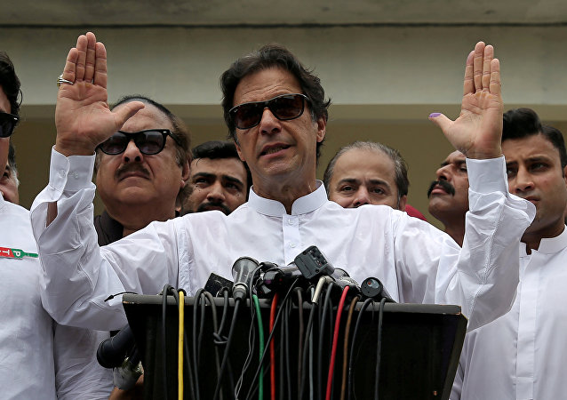 Imran Khan, chairman of Pakistan Tehreek-e-Insaf (PTI), speaks after voting in the general election in Islamabad
