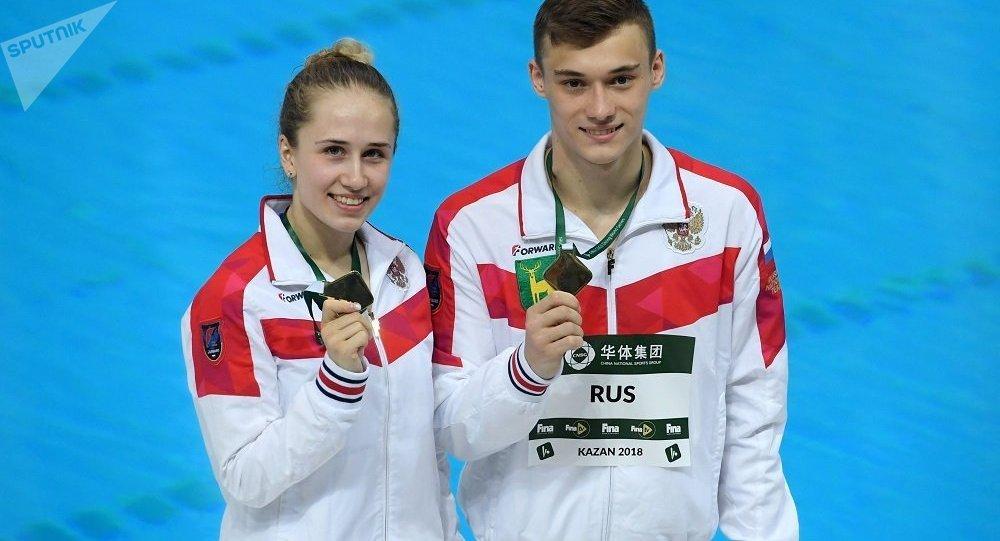 尼基塔•施萊赫爾和尤里婭•季莫什尼娜(資料圖片)